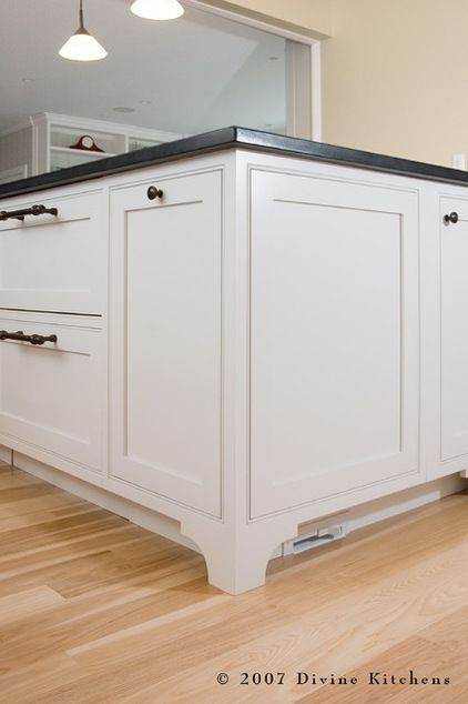 Want other uses for your toe kick? Try a modern central vacuum system. You can incorporate a hidden suction port in the toe kick so crumbs and dust can be swept away without your even bending over. (Traditional Kitchen by Divine Kitchens LLC)