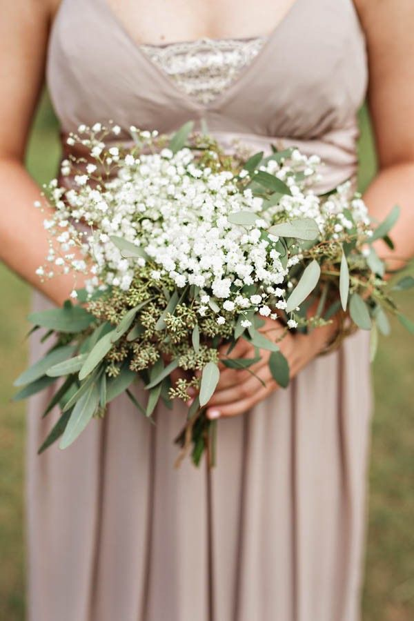 This wedding! Love the baby's breath and eucalyptus for the bridesmaids and pops of purple in brides bouquet.