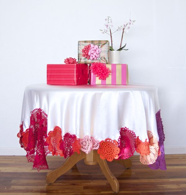 I bet I could just sew glitter if pretty fabric to the bottom of goodwill tablecloths and have it look stunning!