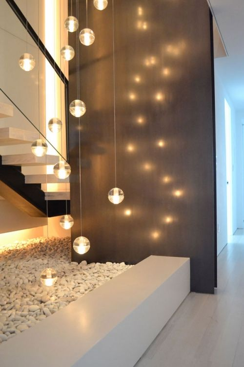 Love the idea of having focal wow lighting in the entry hallway