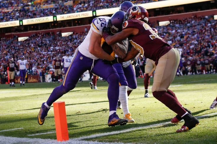 Vikings vs. Redskins:  26-20, Redskins  -  November 13, 2016:   Minnesota Vikings tight end Kyle Rudolph (82) collides with Washington Redskins cornerback Kendall Fuller (38) as he scores a touchdown during the first half of an NFL football game in Landover, Md., Sunday, Nov. 13, 2016.