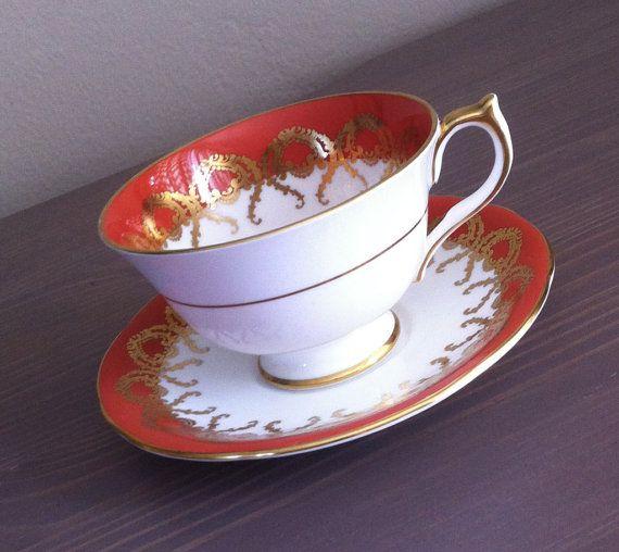 Antique Aynsley burnt orange tea cup and saucer orange and