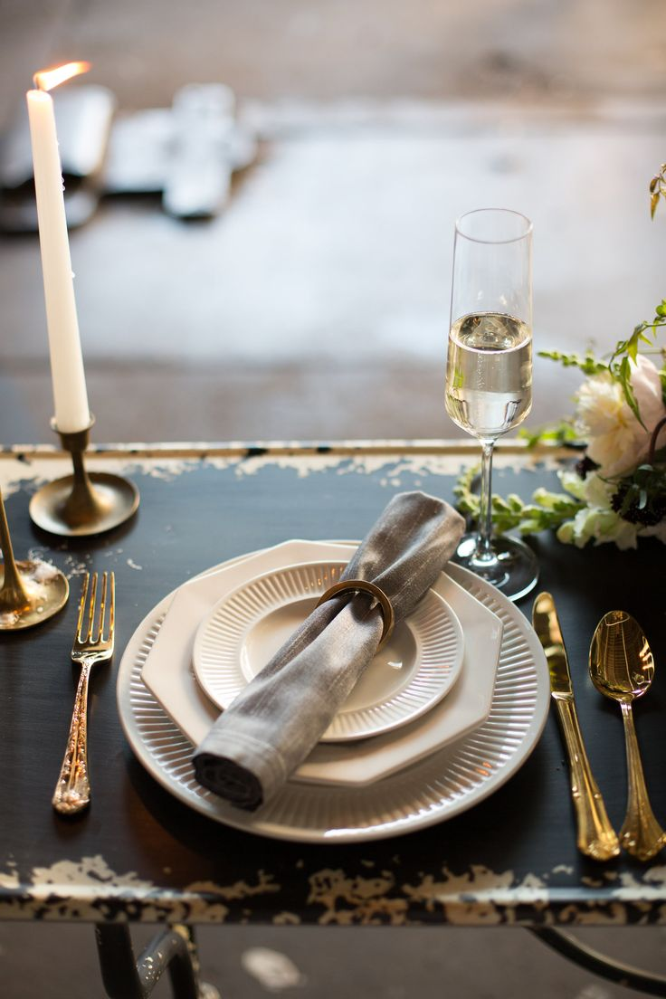 Southern Savvy Events | Placesetting | Urban Wedding | Industrial Event Space | Sweetheart Table | Gold Flatware | White China | Grey Linen Napkin | Monochromatic Details
