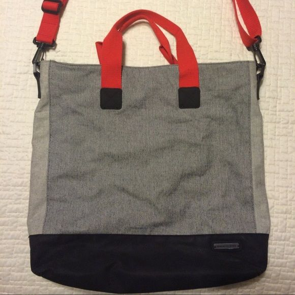 Armani Exchange Tote Bag Excellent size for laptop, tablet, iPad. In excellent condition, barely used. Perfect size for a weekend bag, or just your everyday tote. Inside pocket perfect for phone, keys. Etc... And has adjustable strap. Armani Exchange Bags Totes