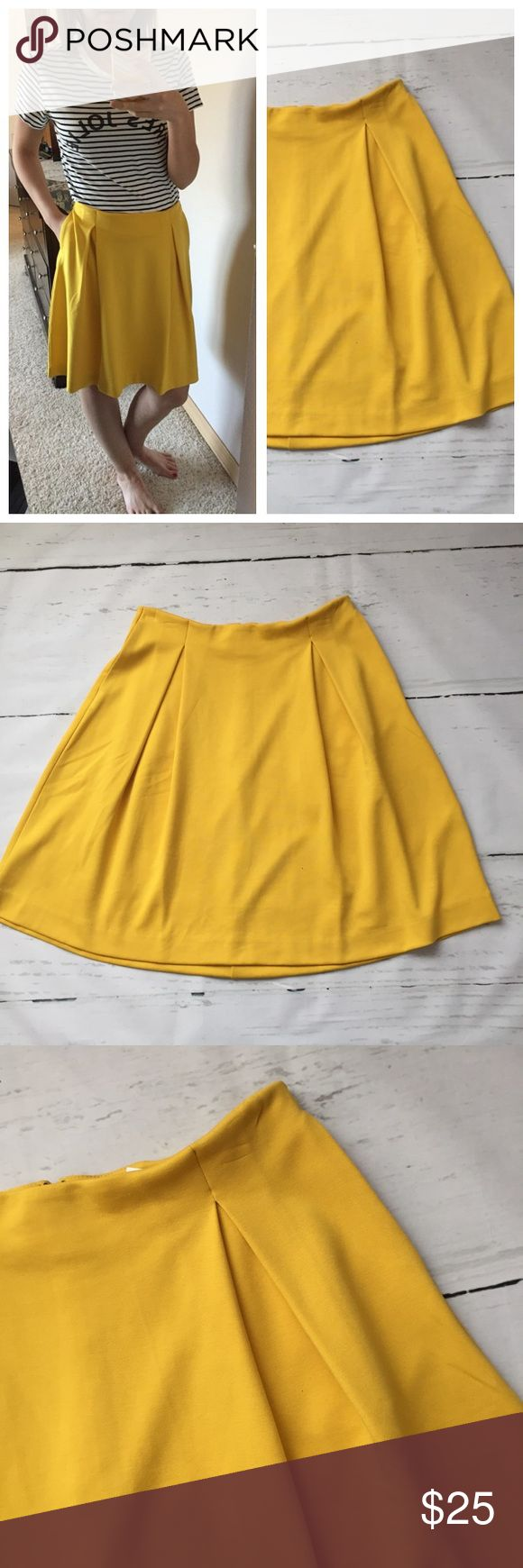 """Banana Republic Yellow Pleated Skirt Banana Republic Bright Yellow Pleated A Line Skirt. Super cute pockets! I'm usually a 4 or 6 and I wore this high waisted. Crease or wrinkle on the side from pant hanger. Shown in las Picture.   Size: 2 Rayon Polyester and Spandex  Measurements: W 13"""" L 20"""" Banana Republic Skirts"""