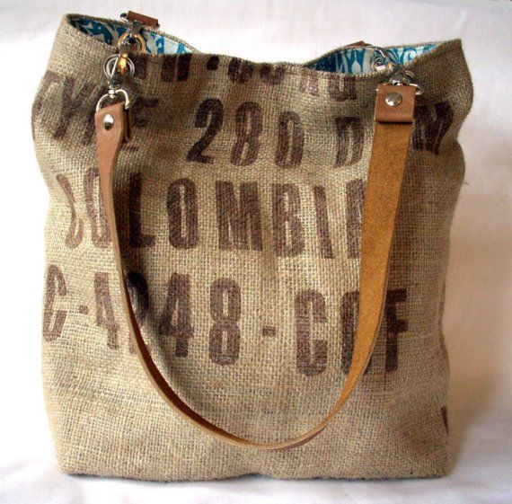 Made from a recycled burlap coffee bean sack, this tote bag features brown leather handles attached with silver clips, and a silver magnetic snap