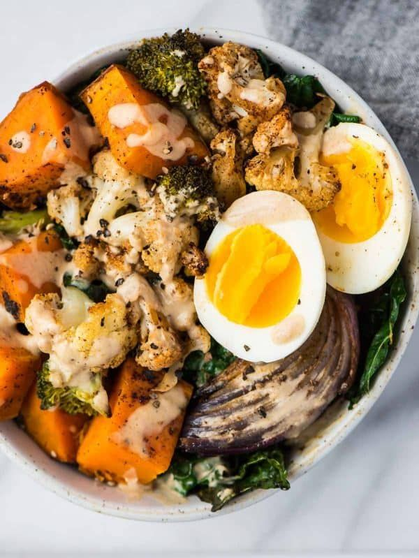 Healthy Whole30 Vegetarian Power Bowl. Roasted veggies topped with a delicious tahini dressing and topped with a protein-packed egg. (Omit the egg if you're looking for a Whole30 vegan breakfast!) A delicious dairy free, gluten free, and Paleo recipe!
