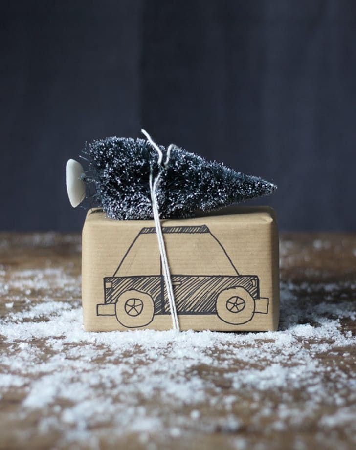 This is a fun one for kids. Help them draw a car onto kraft paper and finish it off with a faux snow-dusted Christmas tree.