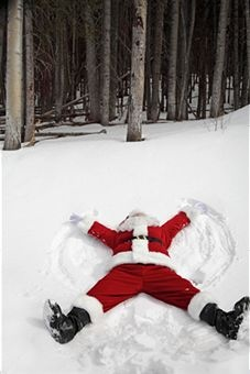 Santa is celebrating NO MORE DELIVERIES this year, making snow angels :) Now he can relax!