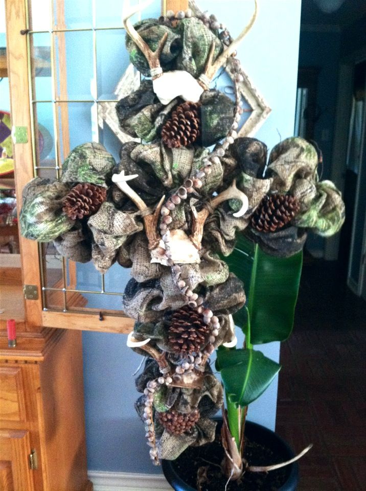 """Cross is 42"""" long,made from camo material with three sets of deer antlers on skill cap.Garland sprials down center made from acorns and pine cones through out wreath.Ready to sale."""