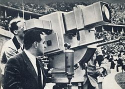 """The """"Olympia-Kanone"""" (Olympic-Cannon) television camera at the 1936 Summer Olympics in Berlin, operated by Walter Bruch.Walter Bruch (2 March 1908, Neustadt an der Weinstraße – 5 May 1990, Hannover) was a German electrical engineer and pioneer of German Television. He invented the PAL color television system at Telefunken in the early 1960s.During World War II he operated a closed-circuit television system installed at the Peenemünde launch site, so that the V-2 rocket launches could be…"""