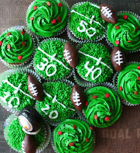 I've decorated football cupcakes like this before & they turned out so cute! Use your favorite icing with food coloring, and for the footballs try chocolate covered almonds, drawing the lines in white icing. So fun!