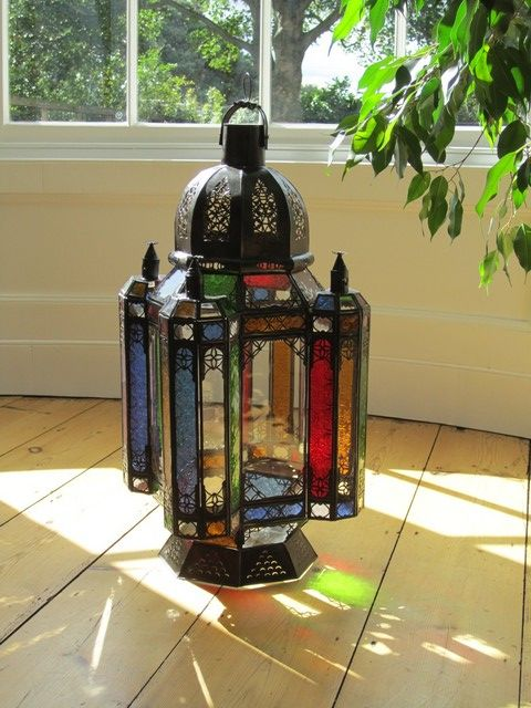 Very large iron lantern with multi-coloured Moroccan glass. http://www.maroque.co.uk/showitem.aspx?id=ENT00125&p=00741