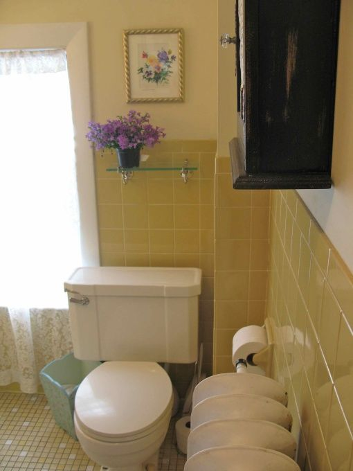 Yellow-Tile Bathroom Makeover: The walls were painted a yellowish white with an old fashioned buttermilk paint. It helps to lighten the look of the yellow tiles.