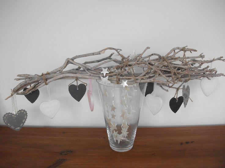 Takken op een vaas, voor als je man niet van gaten in het plafond houdt.