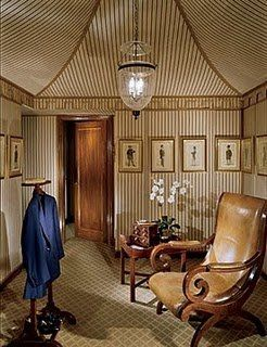 A masculine dressing room designed by Mario Buatta.  Very Napoleon with the tented ceiling.