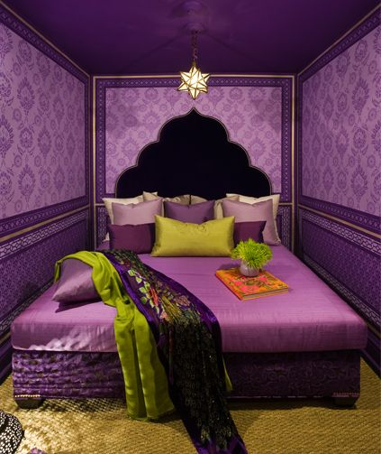 Stunning purple bedroom with purple damask wallpaper walls and a purple ceiling trimmed with a thin gold band.