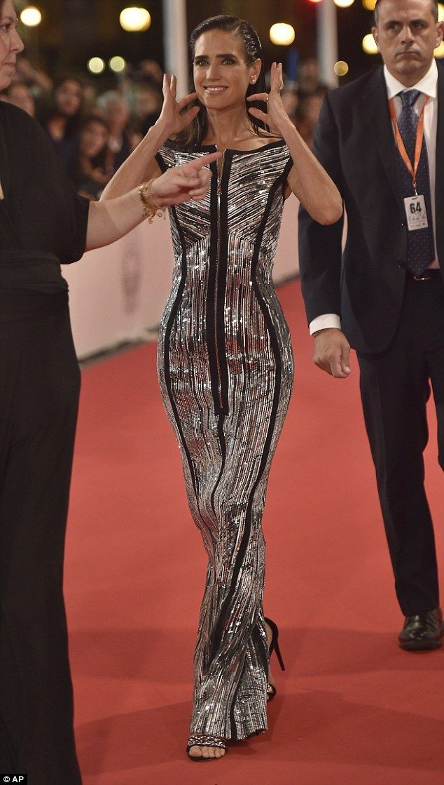 Silver siren: Jennifer Connelly looked stunning in a sleek silver and black gown as she hi...