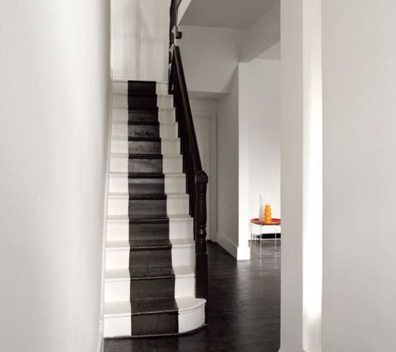 Black floors add drama and make it easy to introduce dark-toned wooden furniture and lux textures on fabrics and upholstery  #BlackPaint #HallwayPaint #Décor #Hallway #Paint #PaintIdeas #Painting #Ireland