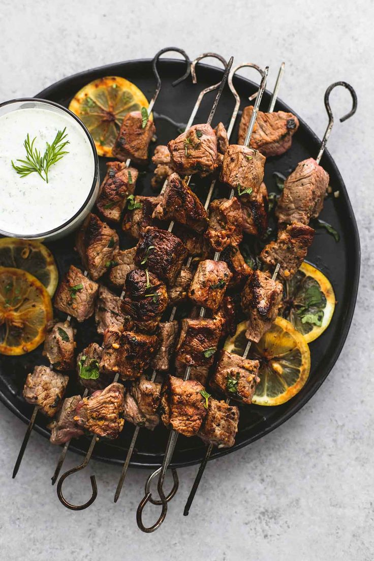 Learn how to make flavorful beef souvlaki kebabs with a simple marinade, served with tzatziki cucumber sauce for dipping.