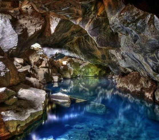 Grjotagja hot water cave (Iceland) - In this cave, John Snow lost his viriginity in the popular TV show, Game of Thrones. A big part of the show is filmed in Iceland and open for visit. More unique travel inspiration in Europe can be found on a map on www.broscene.com !