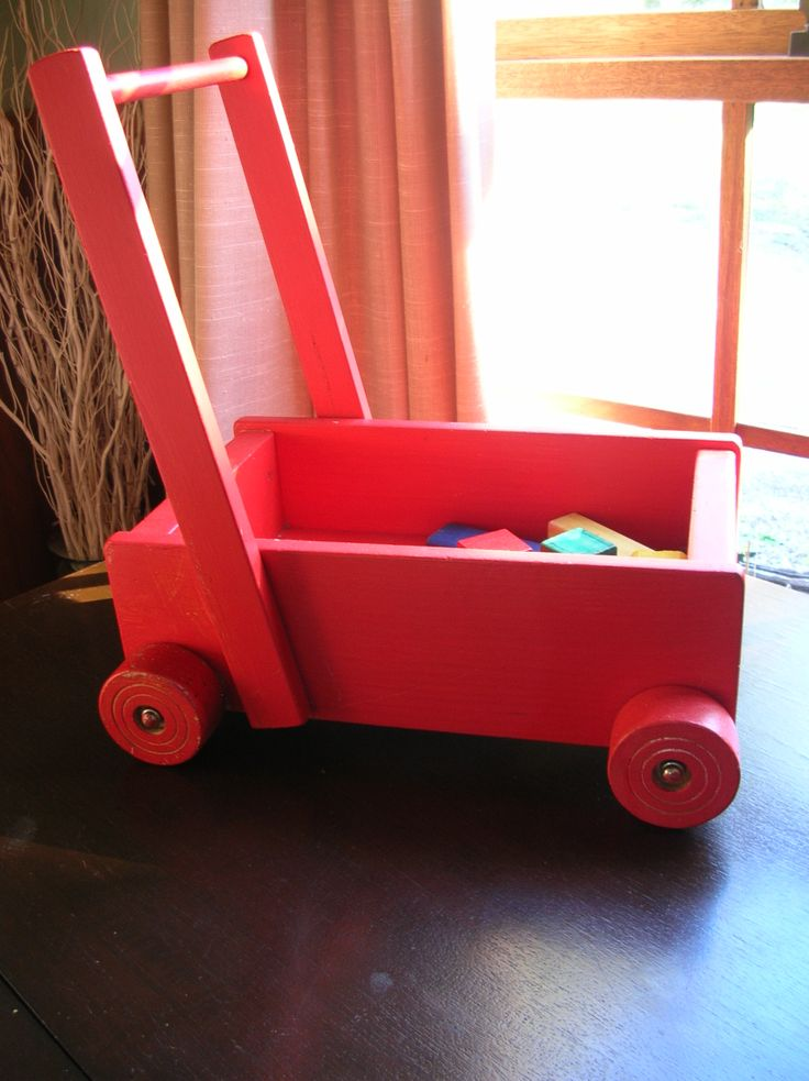 Wooden wagon walker To store wooden blocks in and for babies to learn to walk with. Wheels turn quite slowly, so baby can learn to walk while pushing it.
