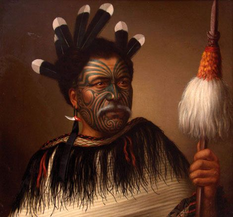New Zeland | Portrait of Chief Ngaio of the Ngati Kahuna, a Highborn Chief.  Seen here holding a Tewhatewha, Adorned with Huia Feathers and a Sharks Tooth Earring | by Gottfried Lindauer (1839 - 1926); oil on canvass