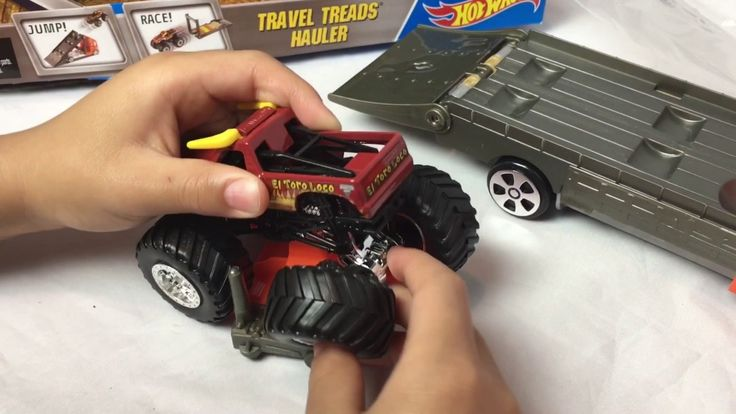 Gideon and Logan unbox and play with the Hot Wheels Off Road Series Travel Treads Hauler - El Toro Loco  ot Wheels Monster Jam Travel Treads Hauler!   Today we are unboxing the Hot Wheels Monster Jam Travel Treads Hauler! This set comes with El Toro Loco! This monster truck has horns and teeth perfect for a crazy bull! It has removable wheels too! This set comes with a gas can a tire jack a support for El Toro Loco (making it easier to put on his wheels!) and four safety cones. These smaller…