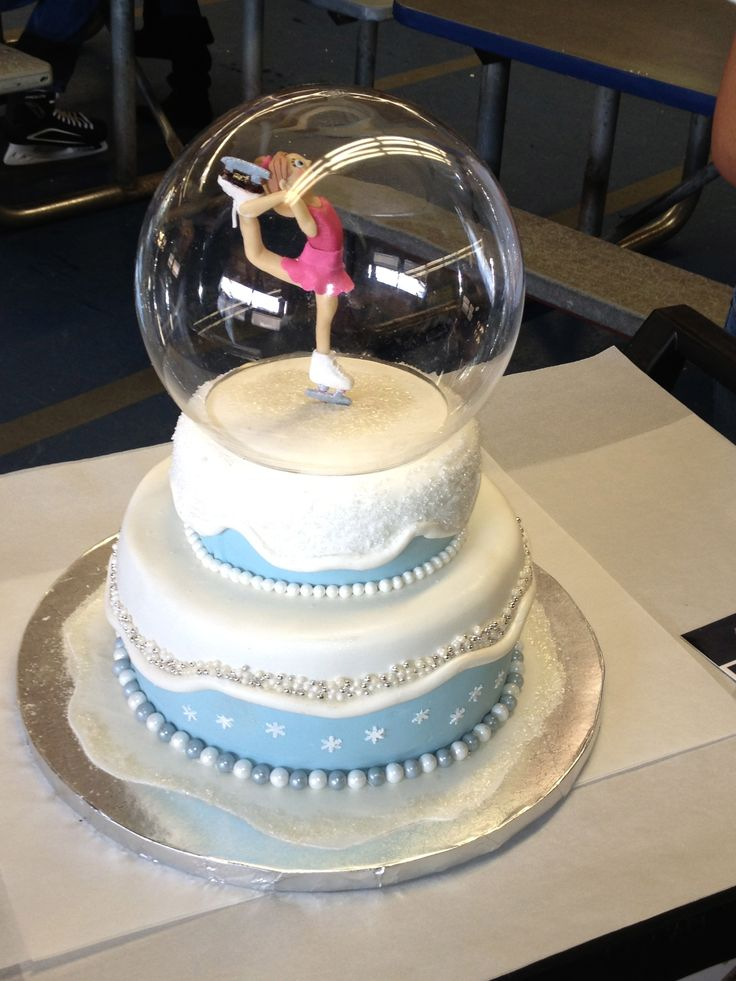 figure skating snow globe - fondant 2 tiered cake with pearl and dragee detail  with acrylic globe.  Figure skater made of fondant.