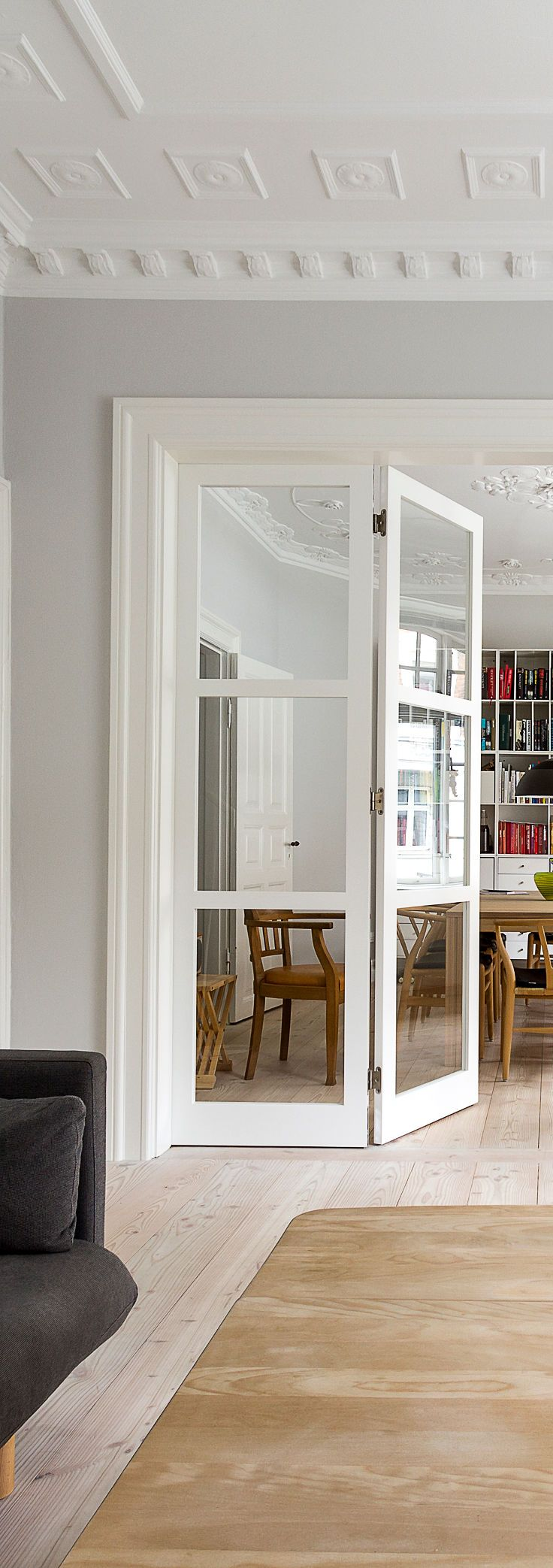 A modern glass door that compliments the style of the classic living room. The…