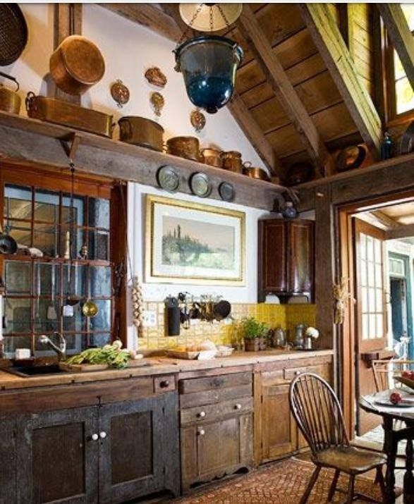 Primitive kitchen. I love the mix of different cabinets
