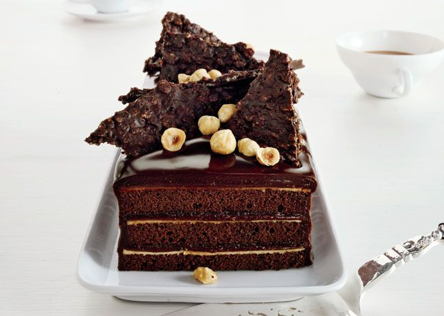 Chocolate Hazelnut Cake with Praline Chocolate Crunch - It's best to make and assemble this stunning layer cake at least one day in advance to let the chocolate, nut, and brandy flavors meld. - I KNOW I CAN MAKE THIS VEGAN    Read More http://www.bonappetit.com/recipes/2011/10/chocolate-hazelnut-cake-with-praline-chocolate-crunch#ixzz1psUeOSuX