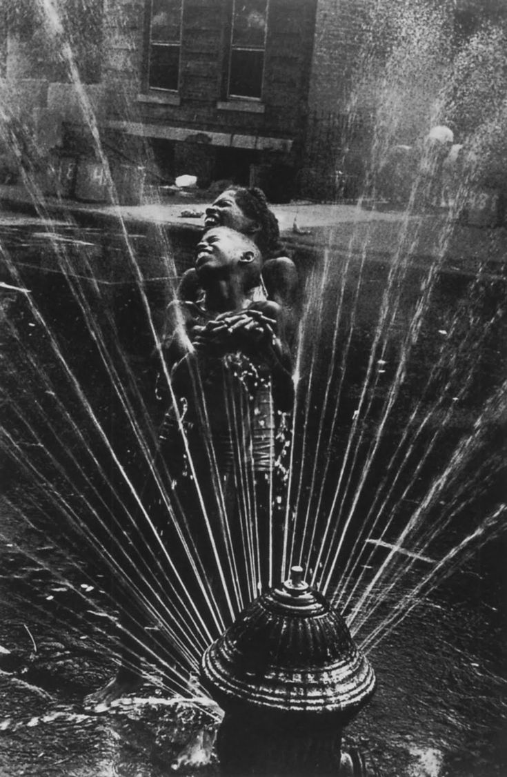 Fire hydrant cool down! Photo by Leonard Freed.  #EcoOla