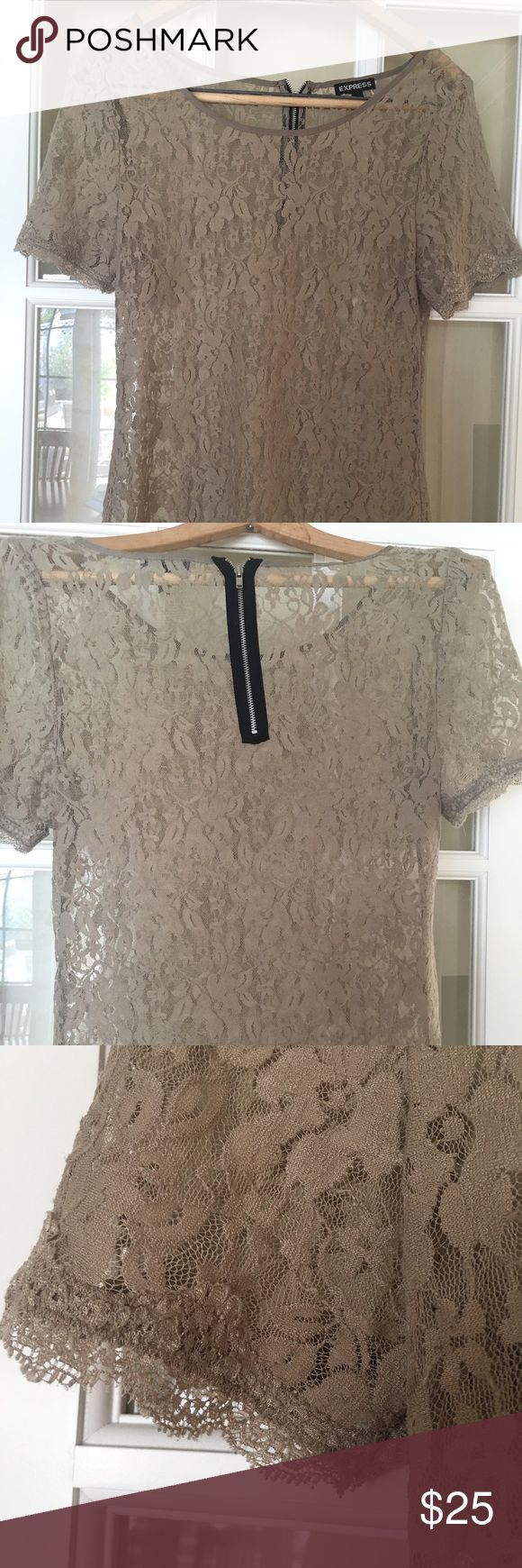 Express Lace see through blouse Beautiful still in Good Condition only used it a handful of times. It's a nude color blouse its medium to long length. It's a size medium but fits a medium to large. The material is made out of 85% nylon, 15% spandex. Zipper in the back. If you have any questions please feel free to ask 😘💕💕💕 Express Tops Blouses
