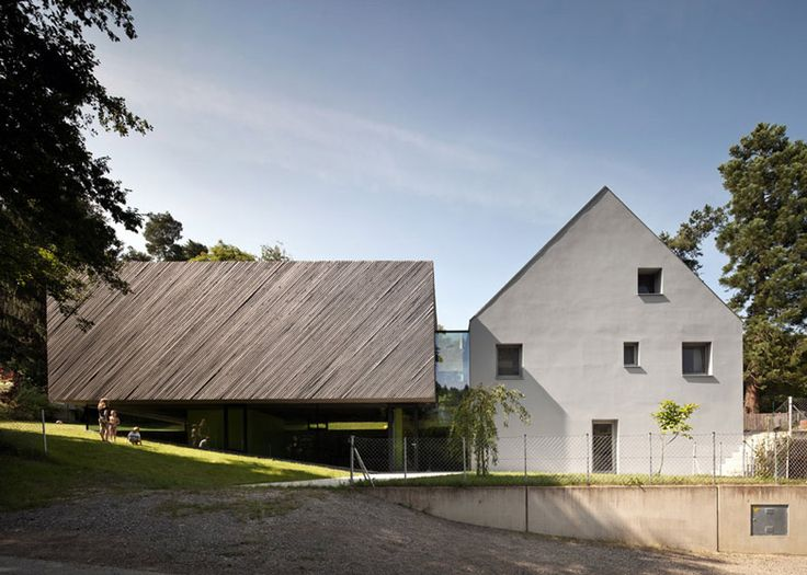 Diagonal strips of wood clad the exterior of this annexe added to a house in the suburbs of Vienna