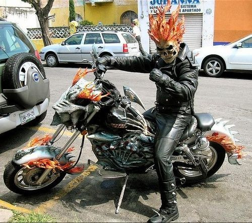 Ghost Rider cosplay. Whoa!!! I like Ghost Rider because I read a comic once where he saved Spider-Man from getting hit by a train!!! Thanks Ghost!