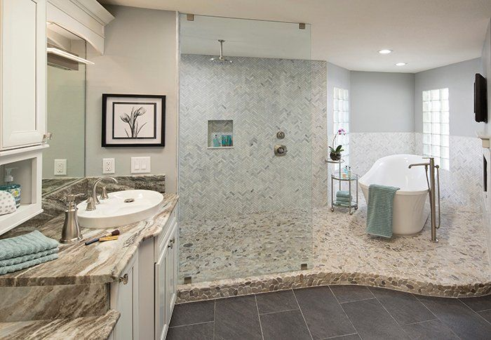 For a relaxing, spa-feel in your bathroom, install pebble floor tile and a rain showerhead.