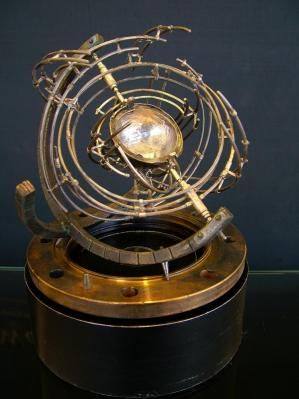 Orrery - a heliocentric model showing the relative movements and position of the moon  + planets