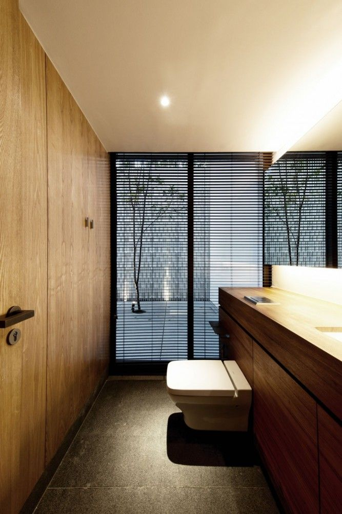 These venetian blinds look ultra modern when the headrail is hidden above ceiling level