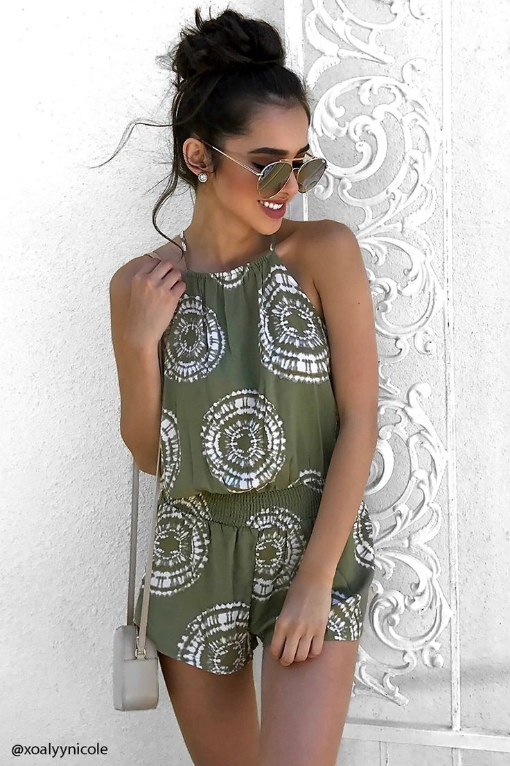A woven cami romper featuring an allover tie-dye wash in a geo pattern, elasticized square neckline, self-tie keyhole back, and an elasticized smock waist.