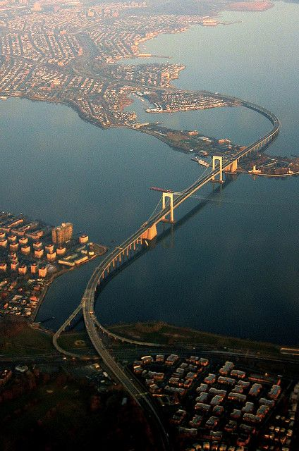 Aerial view of Throgs Neck Bridge, New York City. The Throgs Neck Bridge is a suspension bridge opened on January 11, 1961, which carries Interstate 295 over the East River where it meets the Long Island Sound.