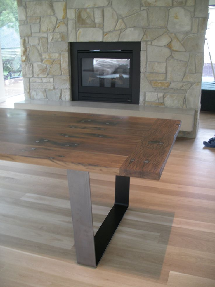 Industrial style dining table made from recycled railway sleepers by Williams & Campion. Maybe we could recreate this?