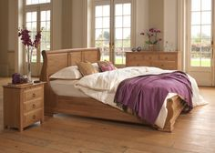 In the heat of a Mediterranean summer, nothing is rushed. Exactly like the precise craftsmanship that goes into our Monaco sleigh bed, seen here in solid oak. The look is grandiose, yet fluid, gently leading the eye from the three individual solid wood panels on the head and footboard to the single piece of wood used for the leg scrolls. All lovingly crafted and hand-set into position. #frenchbeds