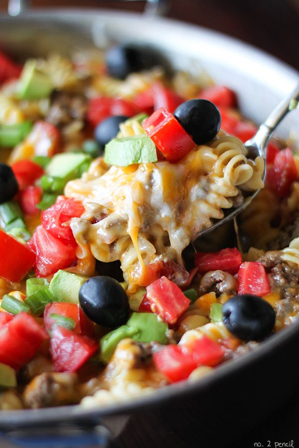 Pasta and ground beef simmered in a flavorful mix of tomatoes, chili powder and cumin and topped with melty cheese, fresh tomatoes and avocados.