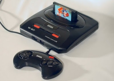 sega mega drive  Loving the 90's have a blue one) the best time killer in my childhood! ^__^