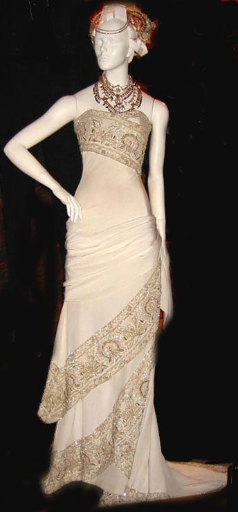 Moulin Rouge Wedding Dress. Image links  to a seamstress that replicates movie costumes with impressive detail!