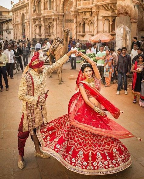 and check out that lehenga while you're at it! damn this love story painting the town red - in an @Anita Dongre lehenga. Photo Courtesy- @Banga Studios (Toronto) #lehenga #redlehenga #lehengaideas #bride #indianbride #indianwedding #IndianWedding #fashion #bridal #inspiration | Curated by #WittyVows - The ultimate guide for the Indian Bride | www.wittyvows.com