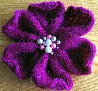 Love these flowers. I used a pretty button in the center and attached a pin to the back so I can wear it.