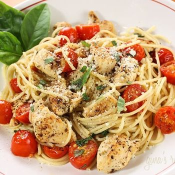 spaghetti with sauteed chicken and grape tomatoes.