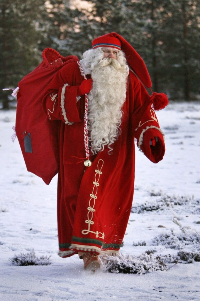 Finnish Santa Claus dressed in a traditional costume. Rovaniemi, Finland. http://d2tq98mqfjyz2l.cloudfront.net/image_cache/1379397210578268_tall.jpg